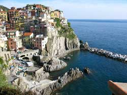 along the coast of the Cinque Terre lies Riomaggiore, a beautiful city along the northwest coast of Italy